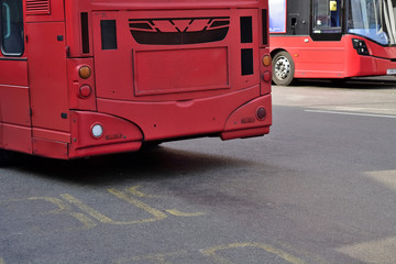 Double Decker red bus is running on road in London