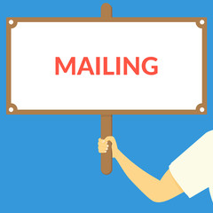 MAILING. Hand holding wooden sign
