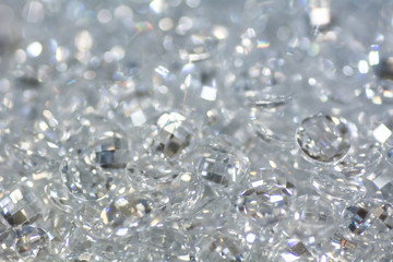 Closeup of many small white zirconia gemstones. Bright luxury background.