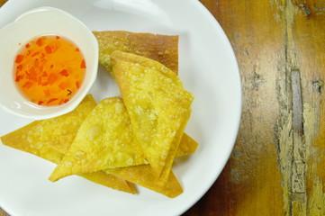 crispy fried dumpling paste dipping sweet chili sauce on plate