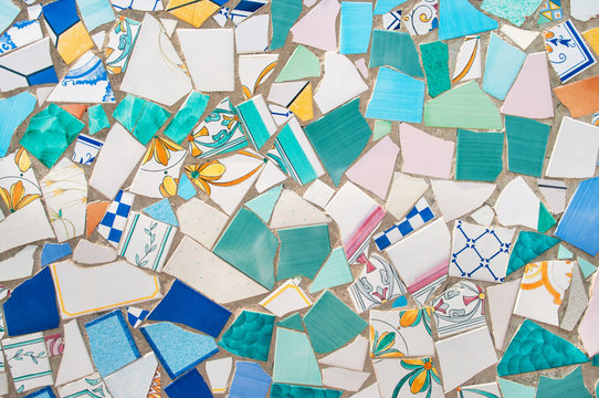 broken pieces of ceramic tiled on wall
