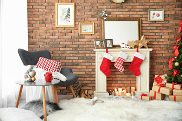 Room interior with beautiful Christmas tree and gifts near decorative fireplace