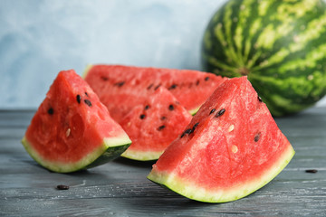 Fresh juicy watermelon with seeds on wooden table