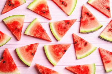 Flat lay composition with watermelon slices on wooden background