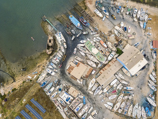 Aerial view of dry docks and shipyard in Olhao, Portugal