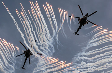 Mil Mi-28 N military helicopters of the Berkuty aerobatic team perform during the Aviadarts competition, as part of the International Army Games 2018, outside Ryazan