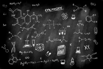 doodle of chemistry formula subject on black chalk board background for education science concept