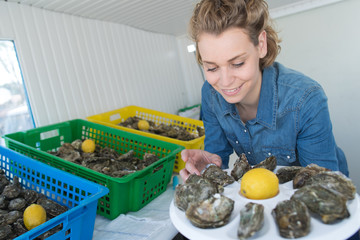 woman preparing a oyster plate to sell