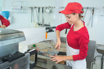 young pretty female cook in restaurant kitchen