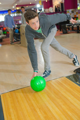 man striking a bowling ball