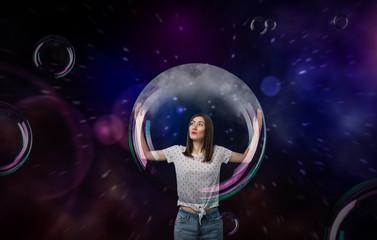 Pretty woman with big soap bubble
