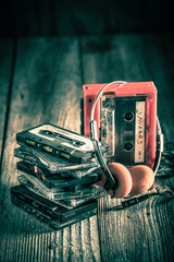 Old cassette tape with walkman and headphones
