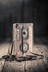 Classic one cassette tape with an extracted tape