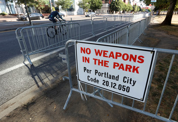 A 'No Weapons' sign is seen at a park where right-wing Patriot Prayer group plan to hold a rally in Portland