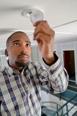 Young man checking a spotlight