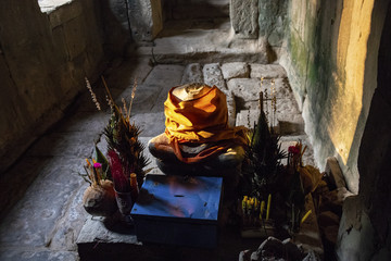 Buddhist altar with ancient stone Buddha statue. Ancient Buddha statue in Ta Prohm temple
