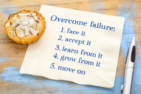 overcome failure concept on napkin