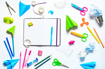 study. it's time to go to school. an empty notebook and everything you need for school. White background. colorful bright office supplies for the school suitable for boys and girls