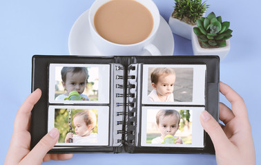 Photo album with instant photos of baby boy