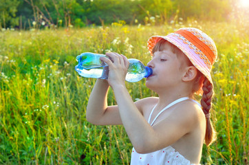 kid, child, drinks water from a plastic bottle