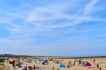 Minnis Bay beach packed with tourists and locals enjoying the sunshine. Birchington, Kent, England, August, 2018