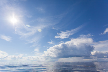 Cumulus white clouds over the water surface of Ladoga Lake. Karelia.