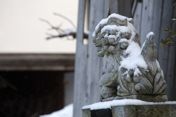 Amazing stone foo or fu dogs in the snow from japan
