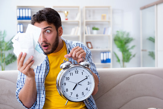 Man frustrated at bills he needs to pay in time management conce