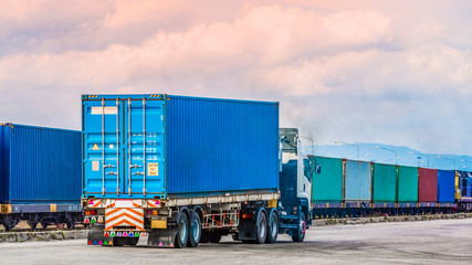 Freight car trailer with cargo container and freight train with cargo containers background, import export business logistic, Auto or automobile business commercial background concept.