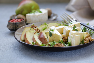 Camembert cheese with pear and fragrant herbs