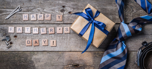 Canvas Prints Textures Father's day concept - present, tie on rustic wood background