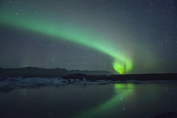 Northern Lights over glacier lagoon in Iceland. Up north northern lights show.