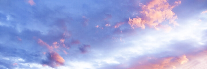 Magnificent pink and white cumulus cloud in blue sky. Australia.