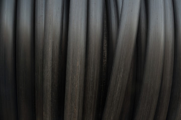 black pipe hose roll background and texture.