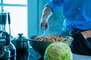 A man in a saucepan cooks food