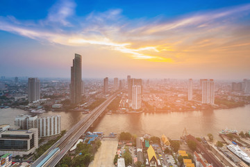 Sunset skyline over cityscape downtown river front, Bangkok Thailand