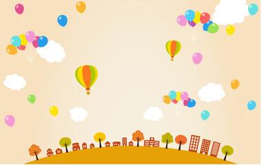 秋の街並みと風船