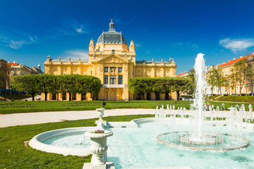 Zagreb, Croatia, art pavilion and fountain in beautiful spring day, colorful 19 century architecture Wall mural