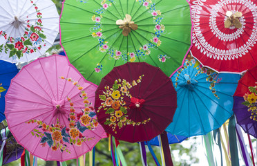 Colorfull Malasian Asian Umbrellas with Flowers on the Top