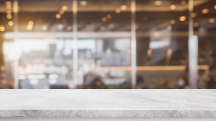 Empty white stone marble table top and blurred abstract background from interior cafe space background - can used for display or montage your products.