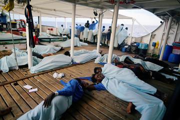 Migrants sleep on board NGO Proactiva Open Arms rescue boat in central Mediterranean Sea