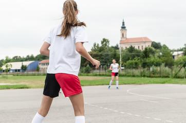 Players of handball playing on court