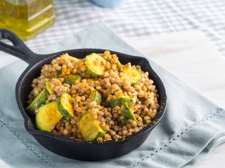 Buckwheat with zucchini and turmeric in cast iron skillet. Easy and healthy lunch for celiac gluten free diet