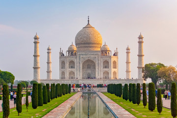 Taj Mahal front view reflected on the reflection pool, an ivory-white marble mausoleum on the south bank of the Yamuna river in Agra, Uttar Pradesh, India. One of the seven wonders of the world.