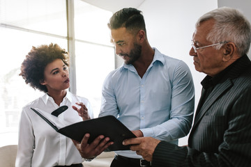 Business team discussing over a business report