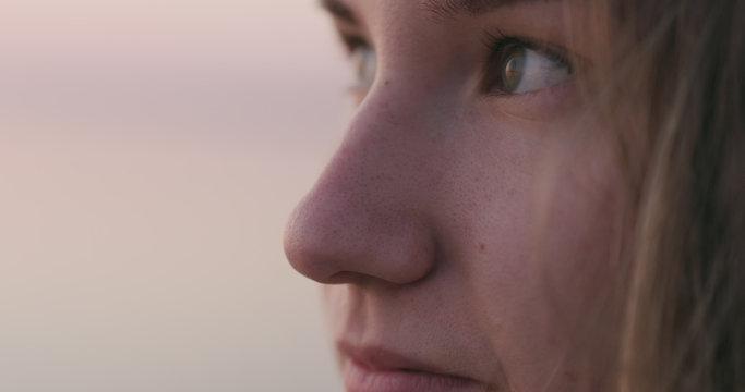 Closeup of teenage girl eye at sunset on a beach