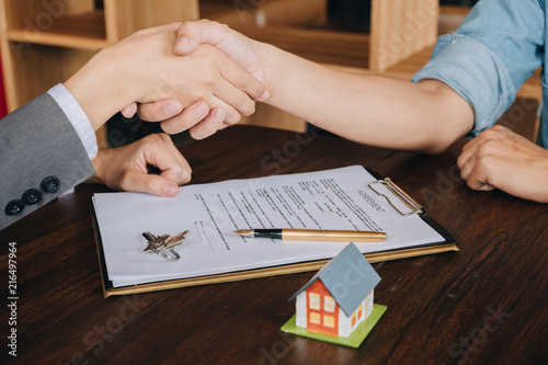 Real Estate Broker Agent Shaking Hands With Customer After Sign