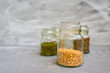 Variety of beans in glass jars