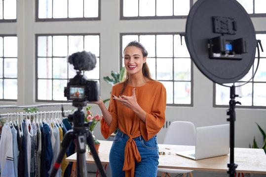 Social media entrepreneur recording daily vlog in studio