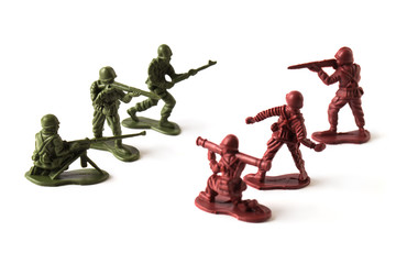 A war battle of toy soldiers, isolated on white background